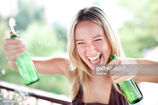 Woman spraying beer