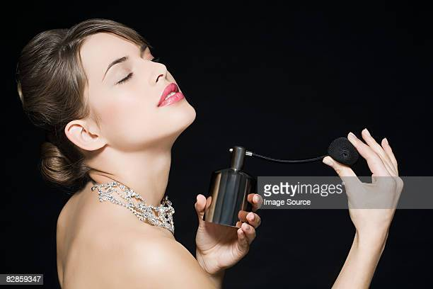 woman spraying perfume - diamond necklace stock pictures, royalty-free photos & images