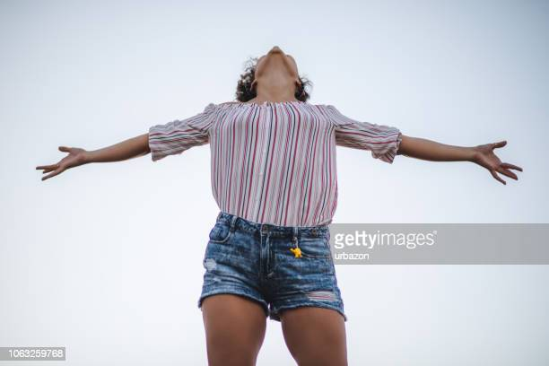woman spreading hands with joy - spreading stock pictures, royalty-free photos & images