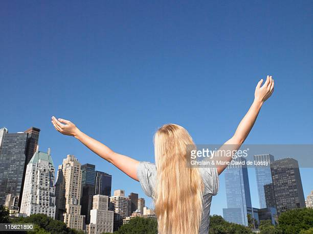 Woman spreading her arms in central park