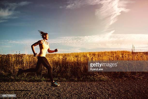 Woman Sprinting on Beautiful Sunset Road