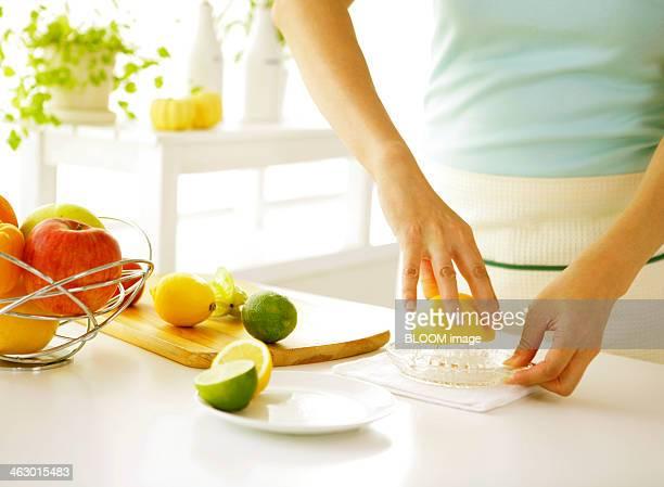 Woman Squeezing An Orange