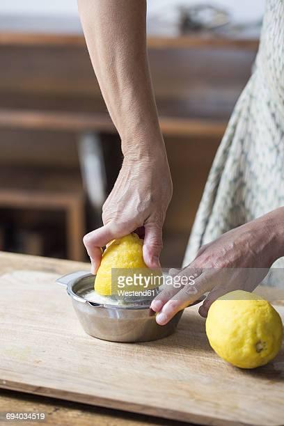 Woman squeezing lemon juice