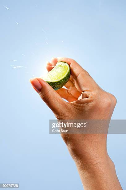 Woman squeezing lime slice