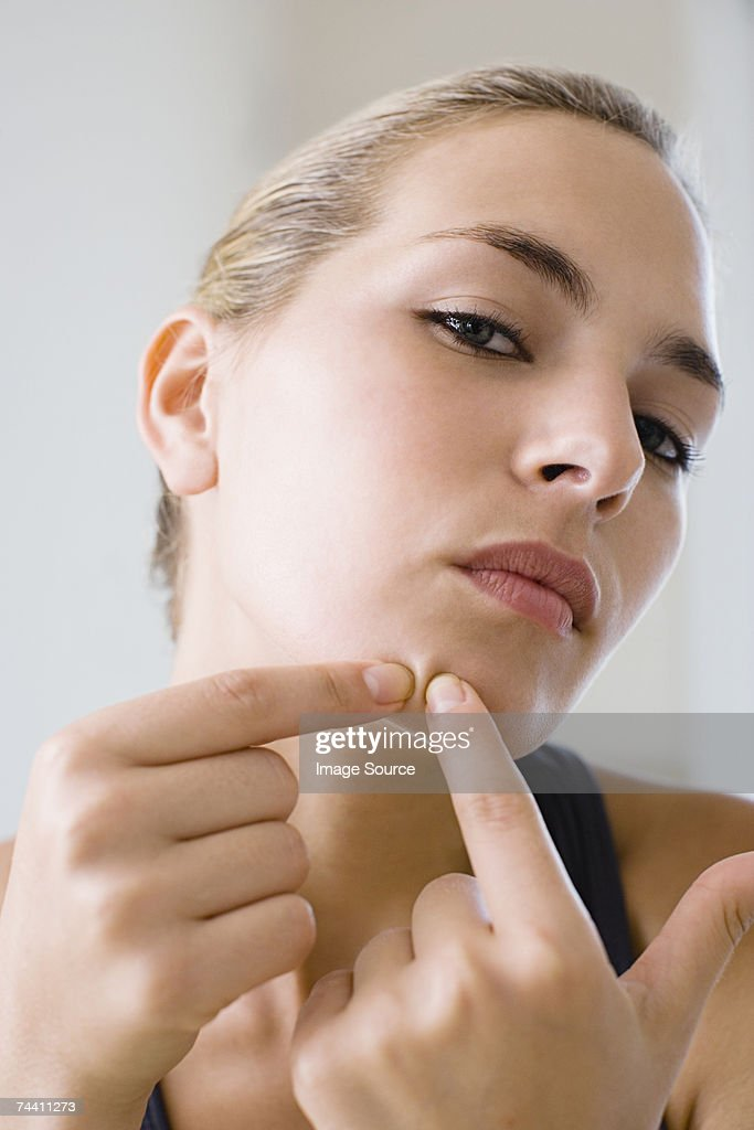 Woman squeezing spot : Stock Photo