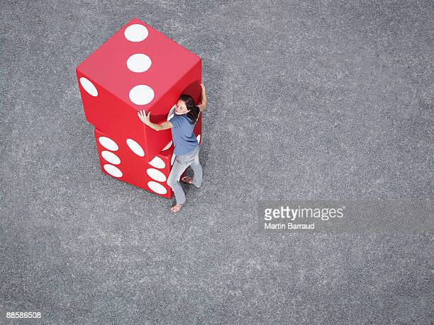 Woman stacking pair of giant dice
