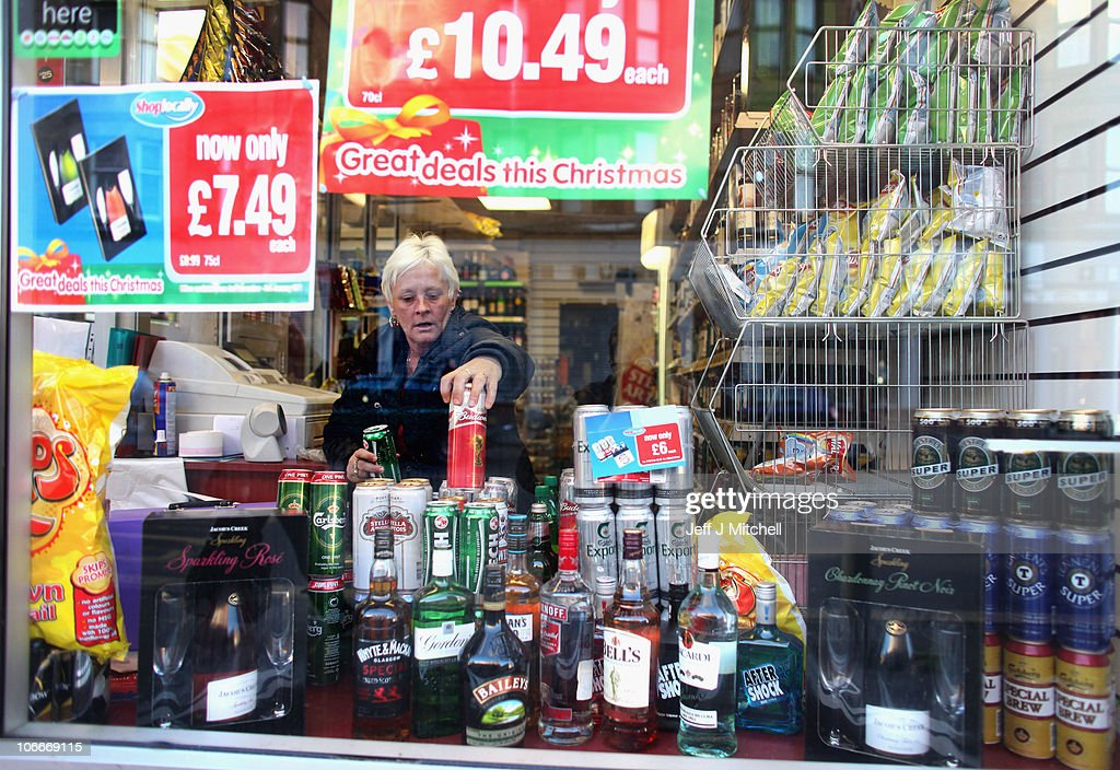 A woman stacks lager in an off licence in Govan on November 10, 2010 in Govan, Glasgow, Scotland. MSP's are set to vote on the SNP government's Alcohol Bill aimed at tackling Scotland's drinking problems. The bill, if it is passed, will see an end to irresponsible drink promotions and will require licensed premises to operate an age verification policy.