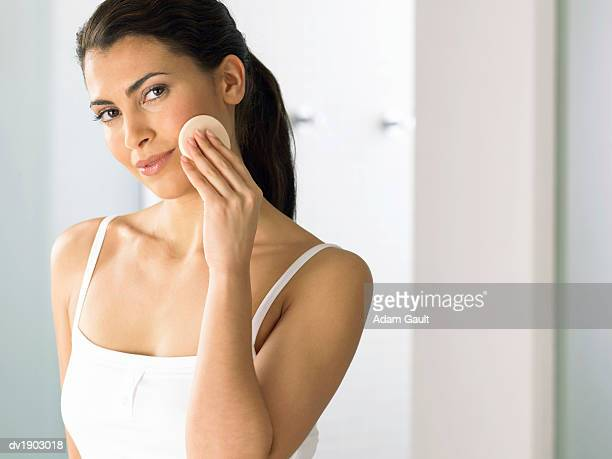 Woman Stand in Her Bathroom Removing Her Make Up