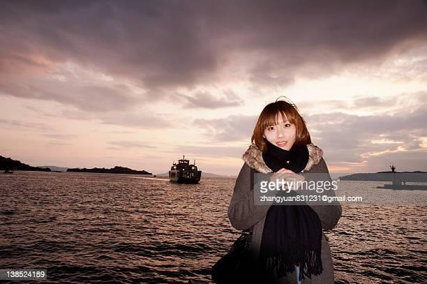 Woman standing against  Aegean sea,okayama,Japan