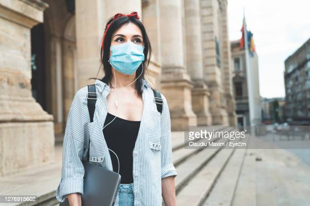 woman standing against building in city - fancy dress costume stock pictures, royalty-free photos & images