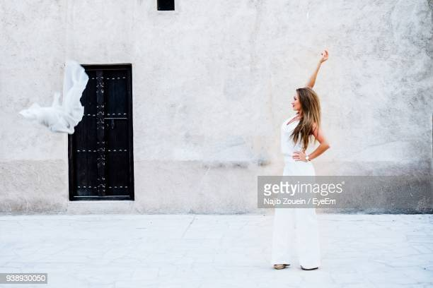 Woman Standing Against House