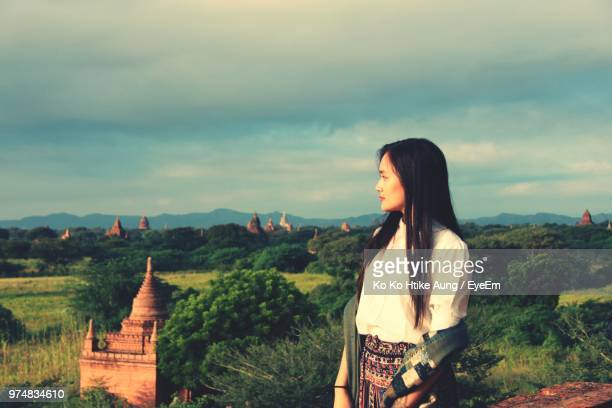 woman standing against landscape - ko ko htike aung stock pictures, royalty-free photos & images