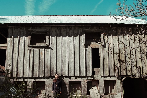 Woman Standing Against Old House - gettyimageskorea