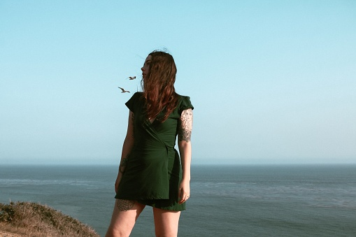 Woman Standing Against Sea And Clear Sky - gettyimageskorea