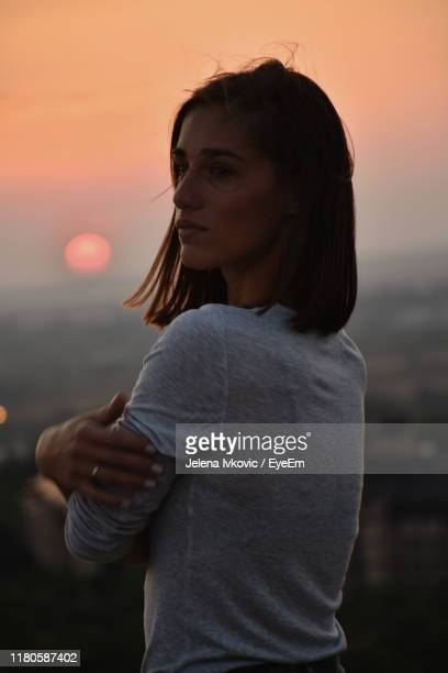 woman standing against sky during sunset - jelena ivkovic stock pictures, royalty-free photos & images