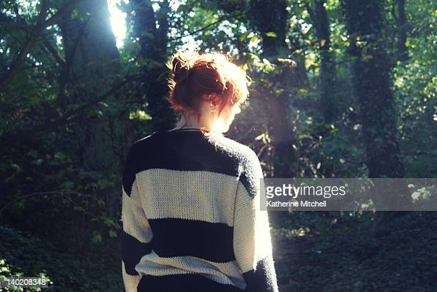 Woman standing against sunlight