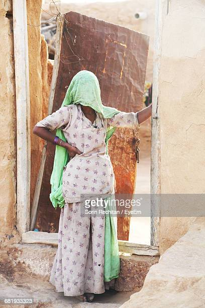 woman standing against the wall - salwar kameez stock pictures, royalty-free photos & images