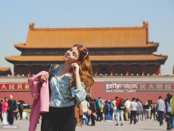 Woman Standing Against Tiananmen Gate
