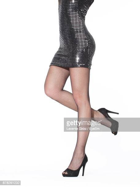 woman standing against white background - legs in nylon stock pictures, royalty-free photos & images