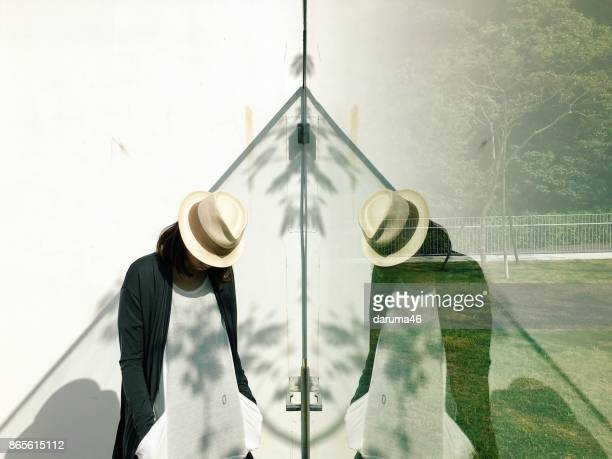 Woman standing and reflection