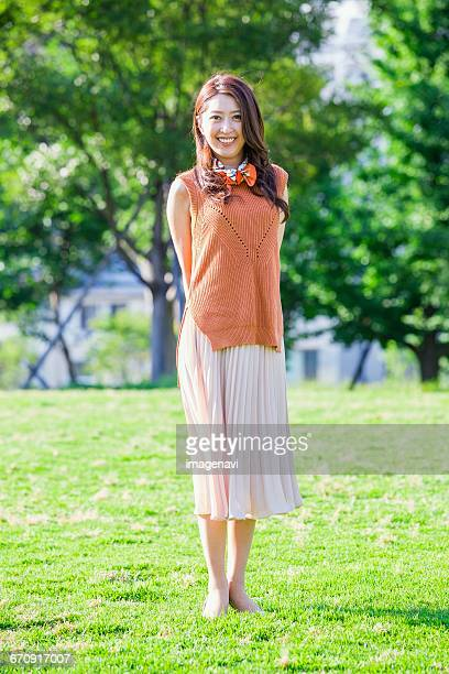 Woman standing at a park