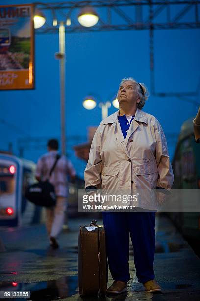 Woman standing at a railroad station platform, Moscow, Russia
