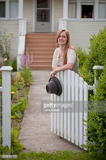 woman standing at an open gate in front of a house; vancouver, british columbia, canada - picket stock pictures, royalty-free photos & images