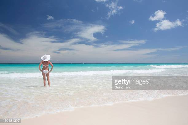 Woman standing at beach.