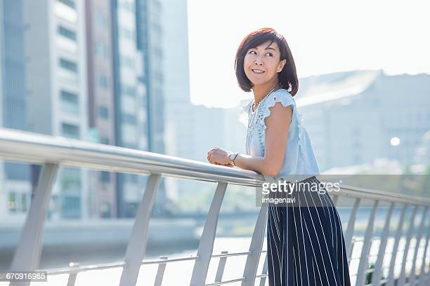 Woman standing at river side in the town