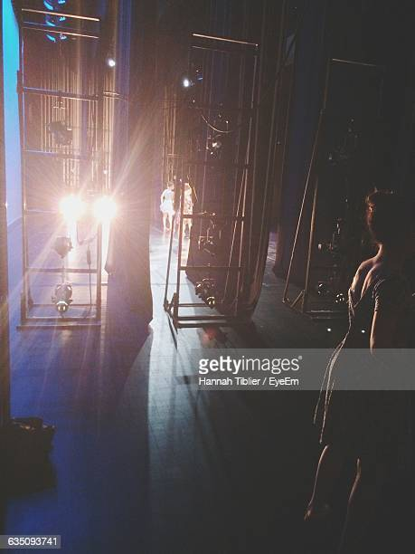 woman standing backstage - backstage stock pictures, royalty-free photos & images
