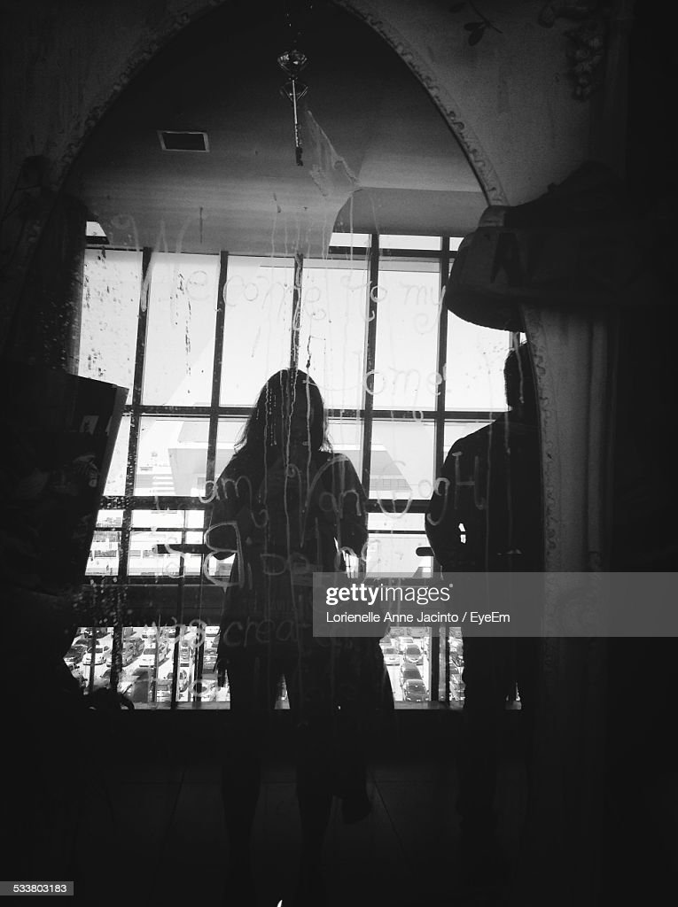 Woman Standing Behind Glass Wall : Foto stock