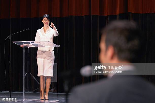 Woman standing behind lectern