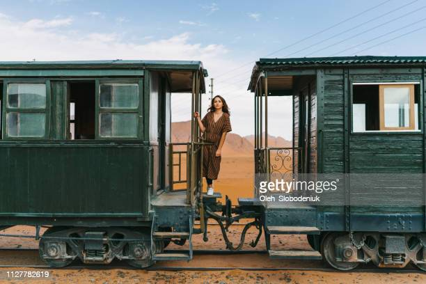 Woman standing between wagons  in old-fashioned train