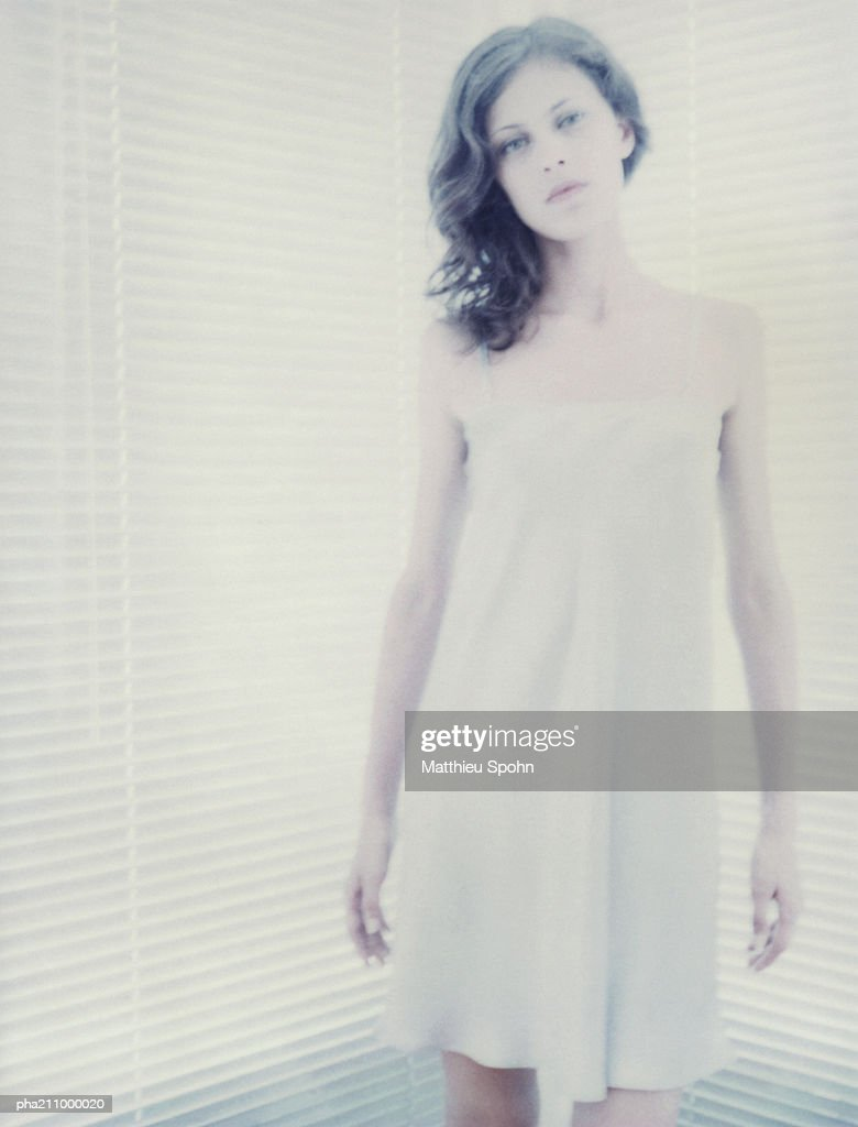 Woman standing, blurred. : Stock Photo