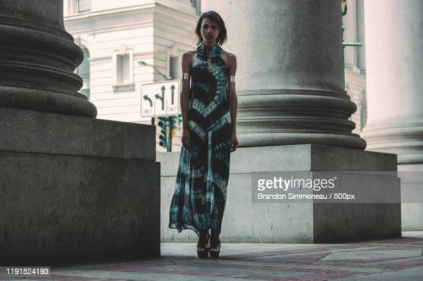 woman standing by column - sheer fabric stock pictures, royalty-free photos & images