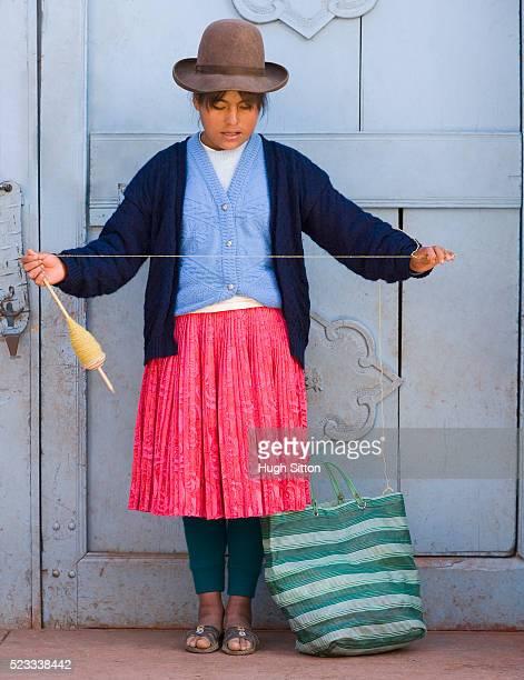 woman standing by door spinning wool - hugh sitton fotografías e imágenes de stock