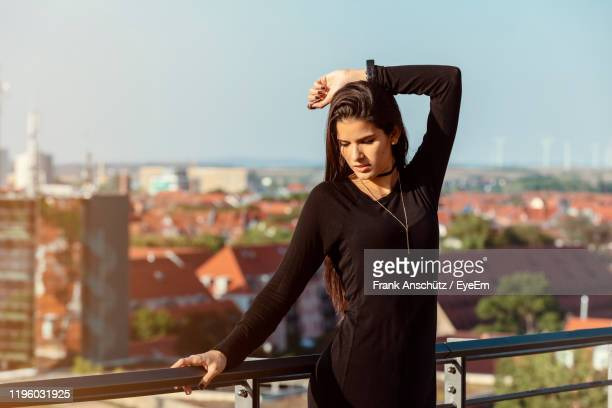 woman standing by railing against clear sky - erfurt stock pictures, royalty-free photos & images