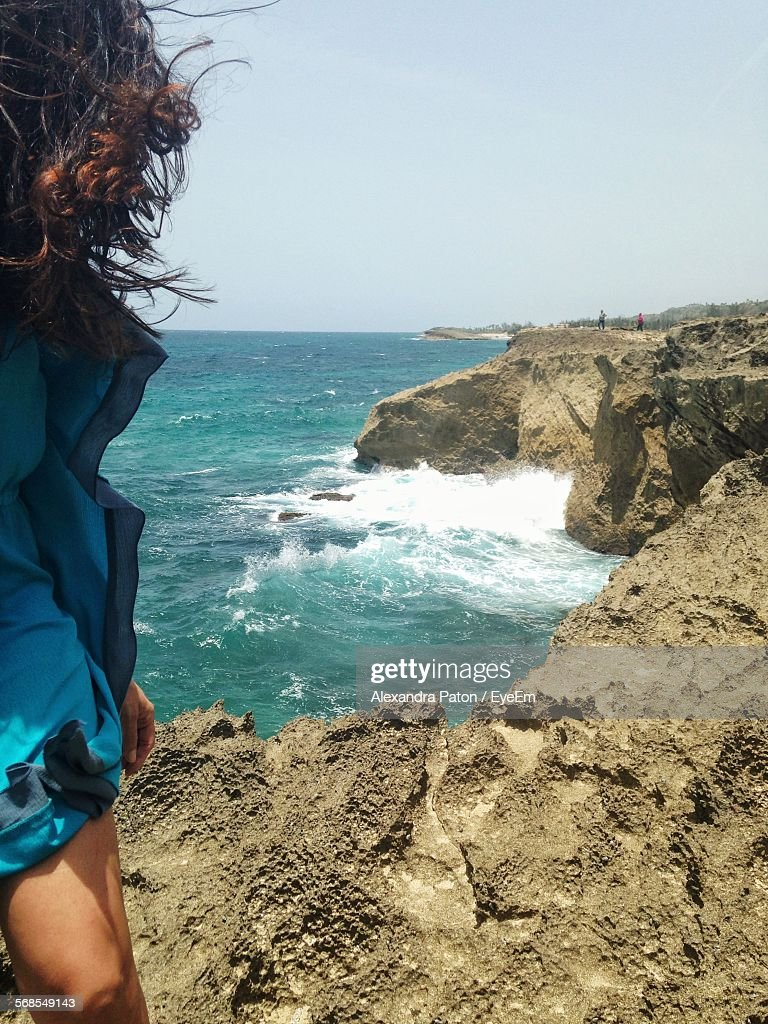 Woman Standing By Sea : Stock Photo