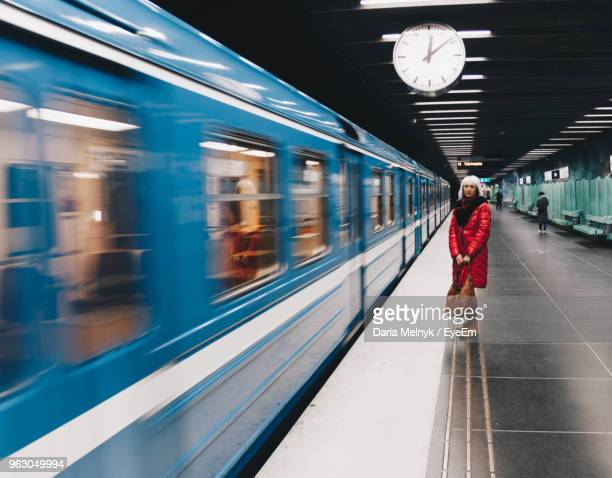 woman standing by train at railroad station platform - subway stock pictures, royalty-free photos & images
