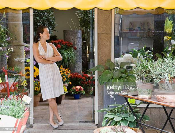 Woman standing in a flower shop