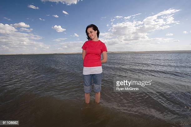 Woman Standing in a Lake