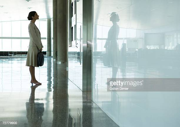 Woman standing in airport concourse
