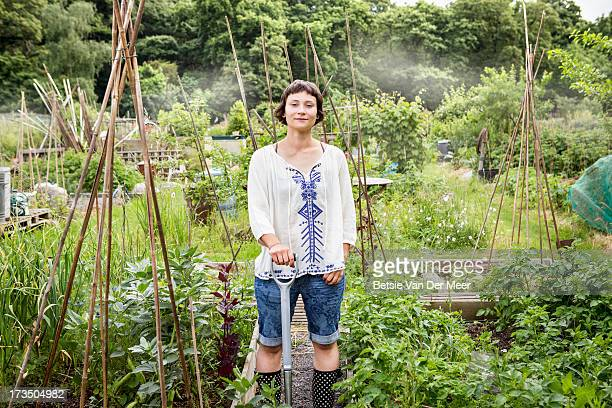 woman standing in allotment garden. - self sufficiency stock pictures, royalty-free photos & images
