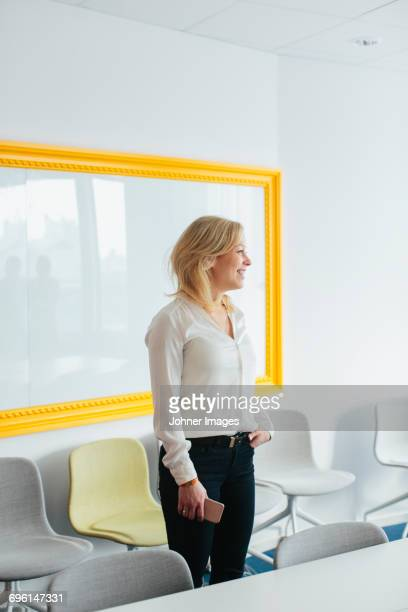 Woman standing in board room