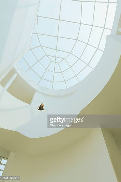 Woman standing in building looking at architecture