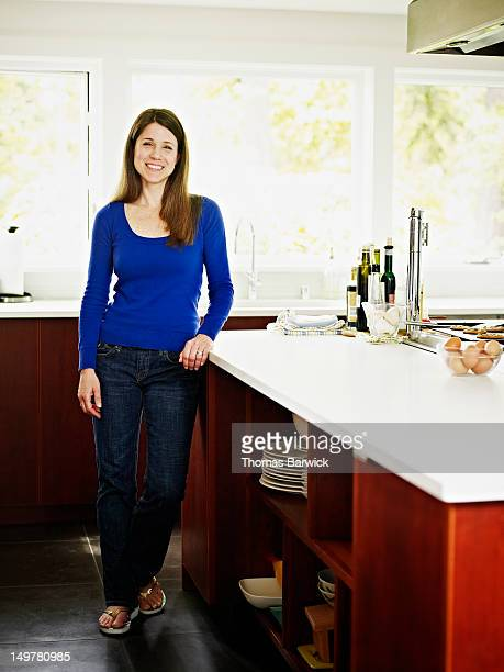 Woman standing in contemporary home kitchen