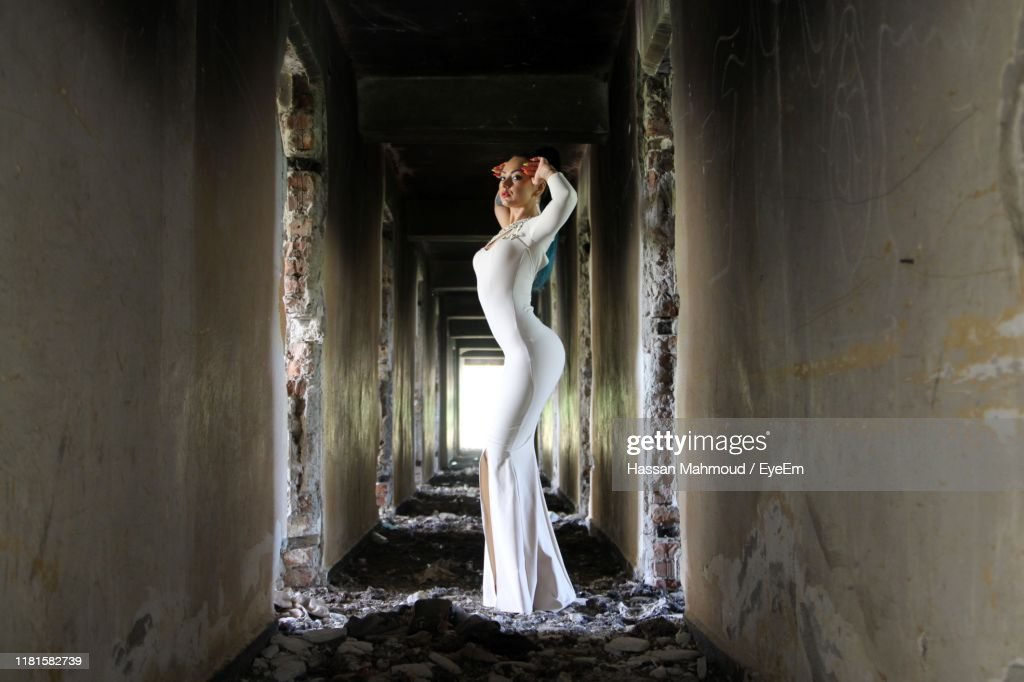 Woman Standing In Corridor Of Abandoned Building High Res Stock Photo Getty Images
