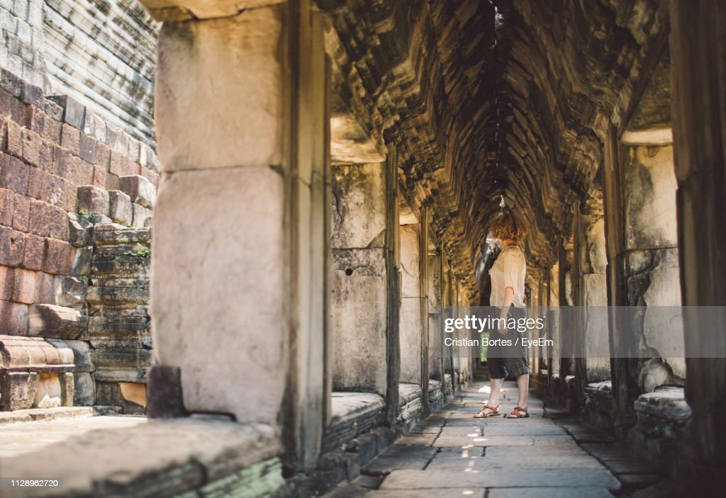 Woman Standing In Corridor Of Building : Stock Photo