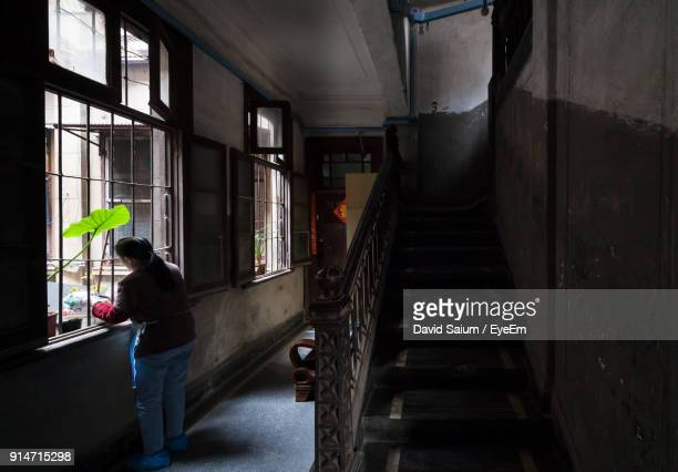 woman standing in corridor - wuhan stock photos and pictures