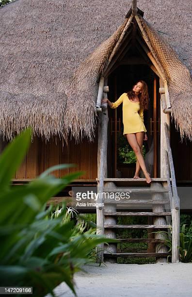 woman standing in doorway of tropical home